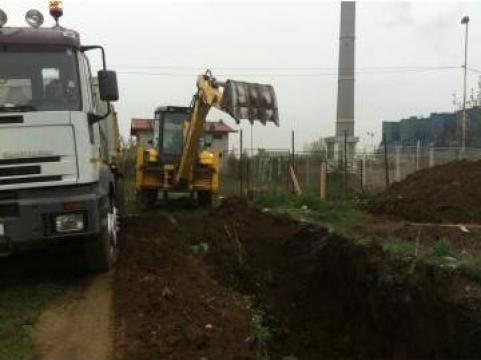 Inchiriere buldoexcavator New Holland LB95 pentru excavatii de la Magazinul De Piese Utilaje Srl